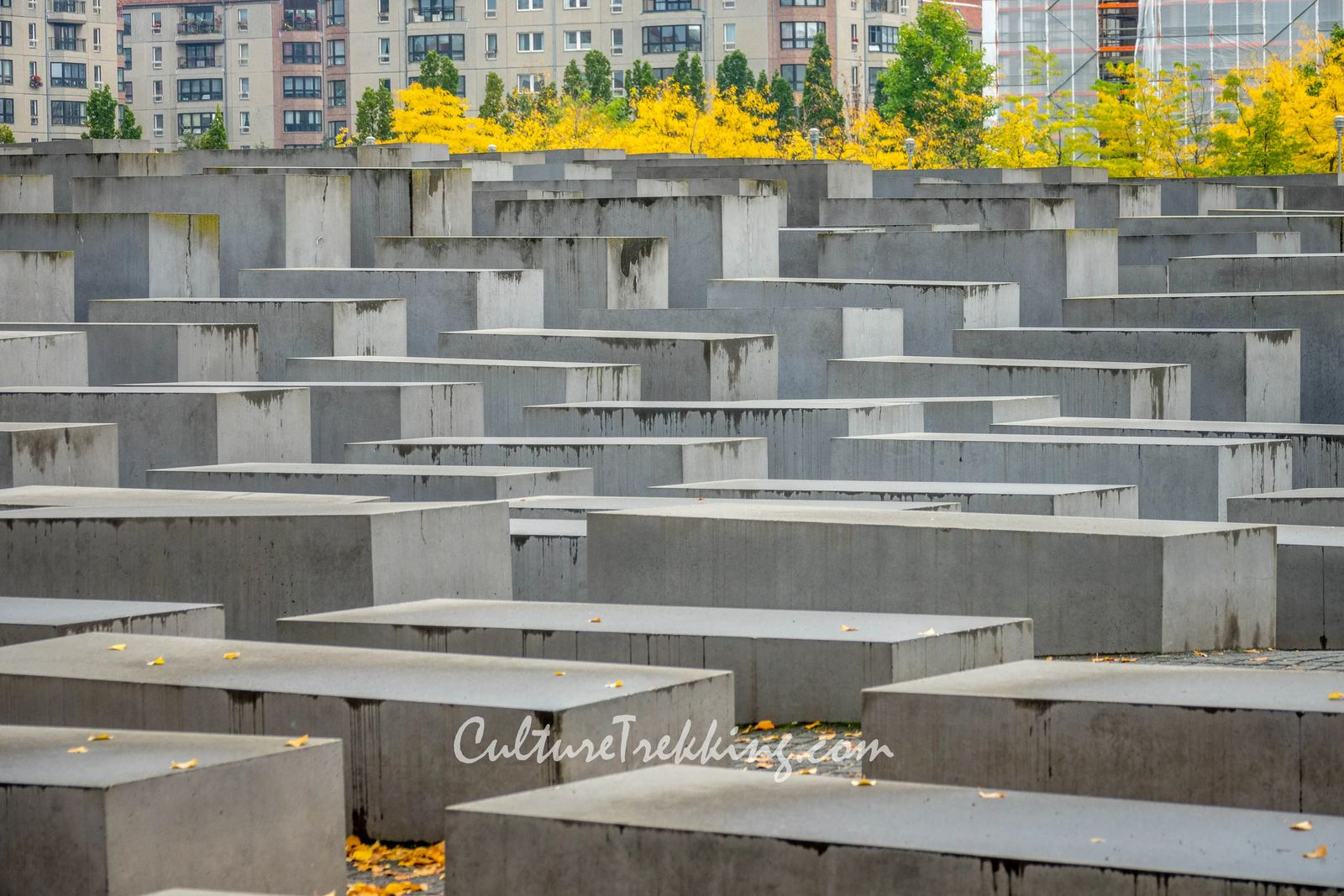 backpacking Eastern Europe 12 hours in Berlin and what to see. Large concrete slabs of varying sizes that resemble Jewish graves