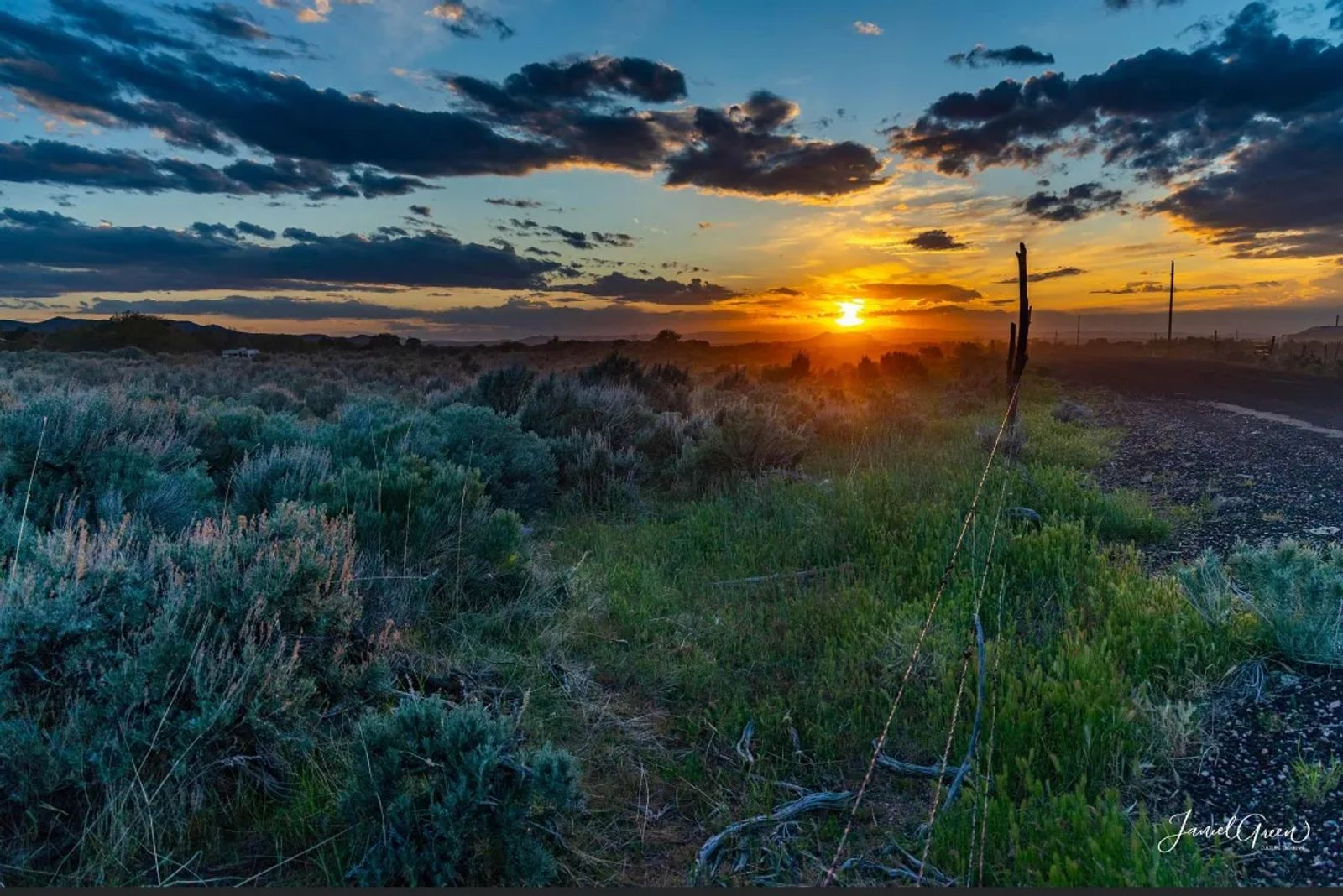 beautiful colorful sunset over a feild of green sage
