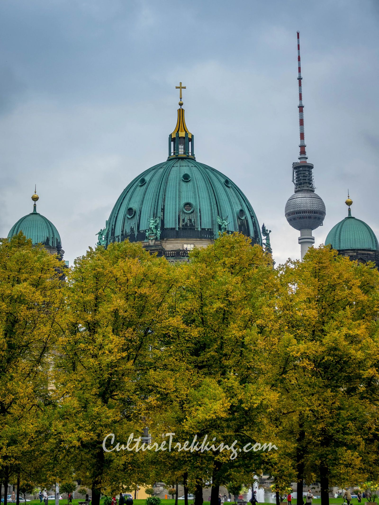 backpacking Eastern Europe 12 hours in berlin and what to see. A church steeple in green topped with a cross and a radio tower in the back